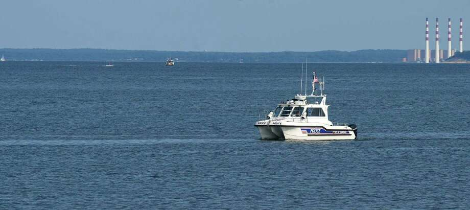 Stamford police are searching the waters off Quigley Beach for two swimmers who may not have returned to shore Monday night. File photo.  Photo: Lindsay Perry / Stamford Advocate