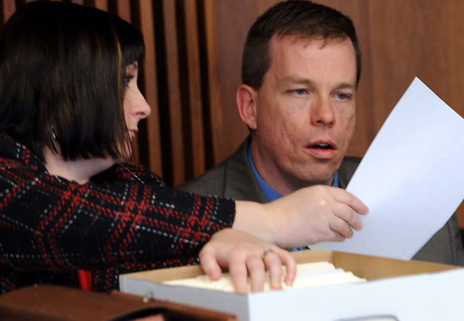 Election Commissioner Brian Quail looks over a document wtih Deputy Election Commissioner Amy Hild in Schenectady County Court in 2011.  (Times Union archive) Photo: Peter R. Barber / Peter R. Barber
