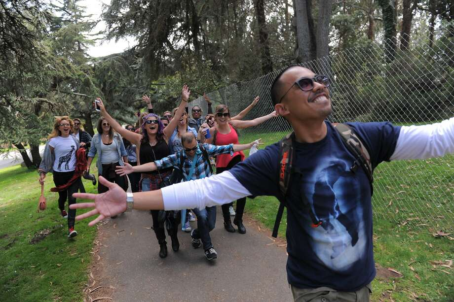 Christian Ramos of Oakland leads the group to Outside Lands Music Festival in Golden Gate Park on August 08, 2014 in San Francisco, CA. Photo: Craig Hudson, The Chronicle