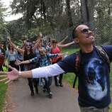 Christian Ramos of Oakland leads the group to Outside Lands Music Festival in Golden Gate Park on August 08, 2014 in San Francisco, CA.