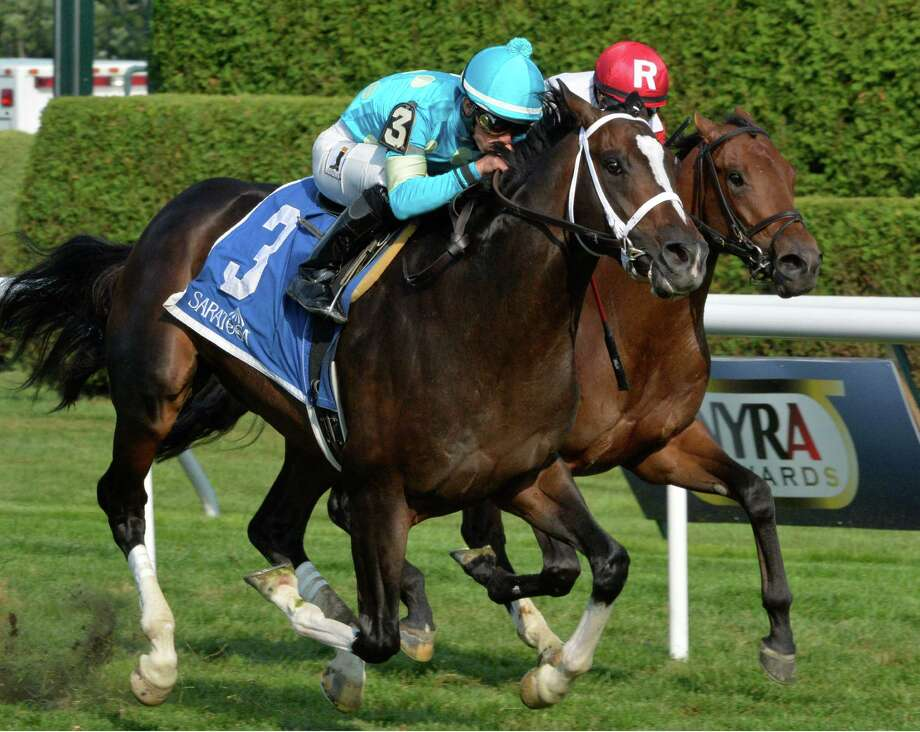 #3Wallyanna with jockey Irad Ortiz Jr. drives by race favorite Bobby's Kitten with jockey Javier Castellano To win the 30th running of The National Museum of Racing Hall of Fame Friday afternoon Aug. 8, 2014 at the Saratoga Race Course in Saratoga Springs, N.Y.     (Skip Dickstein/Times Union) Photo: SKIP DICKSTEIN