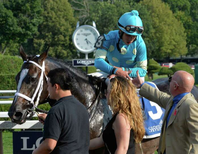Jockey Irad Ortiz Jr. is congratulated by the connections of Wallyanna after winning the 30th runnin