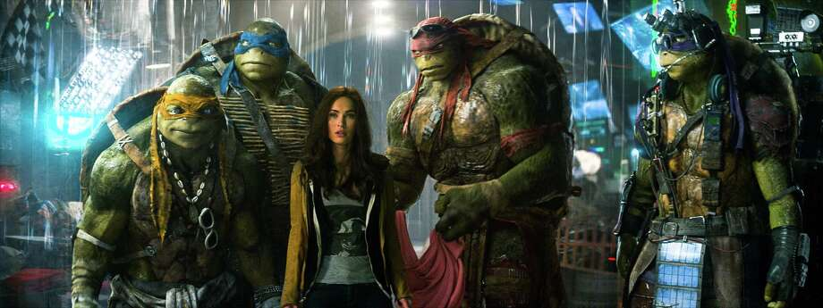 "This image released by Paramount Pictures shows, from left, Michelangelo, Leonardo, Megan Fox, as April O'Neil, Raphael, and Donatello in a scene from ""Teenage Mutant Ninja Turtles."" Photo: Industrial Light & Magic, AP / Paramount Pictures"