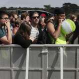 Festival goers wait for Holy Ghost to perform at Outside Lands on Friday, Aug. 8, 2014 in San Francisco, Calif. Outside Lands is expected to draw in as many as 180,000 people this weekend.
