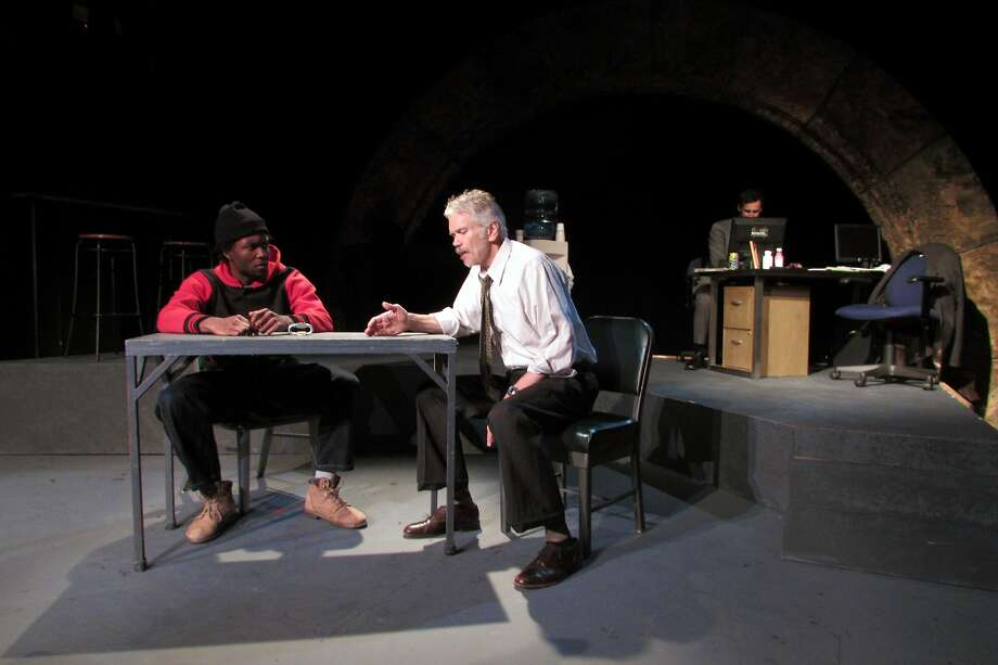 "Isiah Thompson (left) appears as William, a ""person of interest"" being interrogated by Detective Denny Mitchell, played by Charles Shaw Robinson, in Rhett Rossi's drama brimming with hot-button social issues. Photo: Jordan Puckett"
