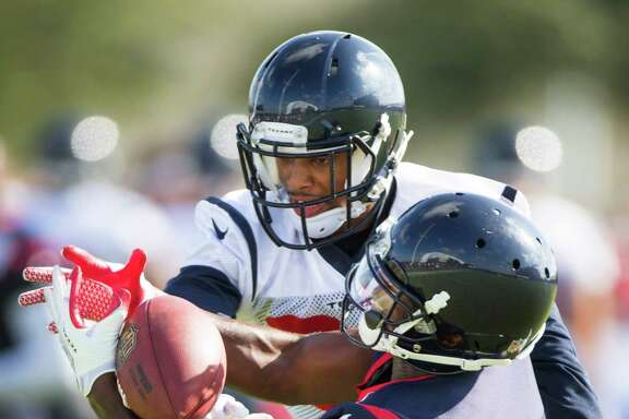 A.J. Bouye, left, breaks up a pass intended for Alec Lemon at camp. Bouye is competing to be the first Texans cornerback off the bench.