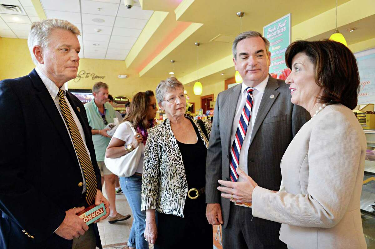 Lieutenant governor candidate Kathy Hochul, right, meets with , from left, New York State Canal Corporation Director Brian Strattonand, a former Schenectady Mayor, County Legislature Vice Chair Karen Johnson, also a former Schenectady Mayor and Schenectady Mayor Gary McCarthy at Villa Italia Bakery Friday August 8, 2014, in Schenectady, NY. (John Carl D'Annibale / Times Union)