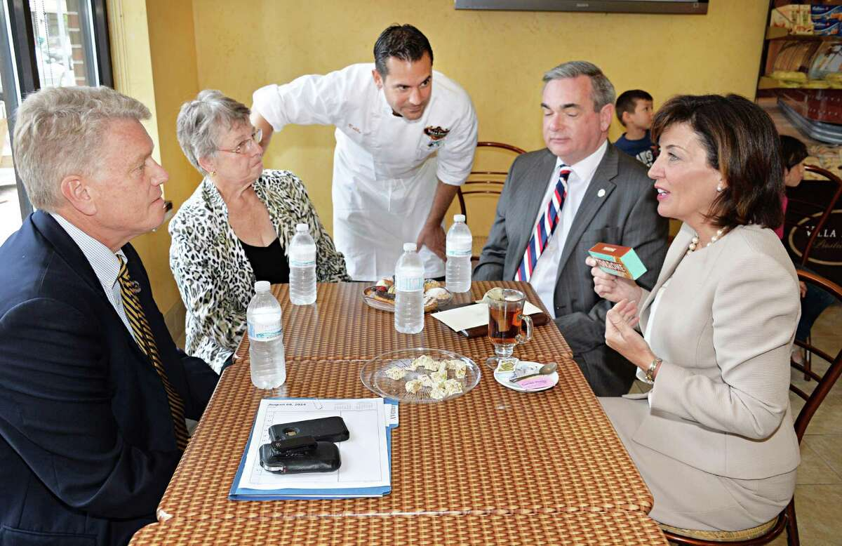 Lieutenant governor candidate Kathy Hochul, right, with, from left, New York State Canal Corporation Director Brian Strattonand, a former Schenectady Mayor, County Legislature Vice Chair Karen Johnson, also a former Schenectady Mayor, Villa Italia owner Bobby Mallozzi and Schenectady Mayor Gary McCarthy at Villa Italia Bakery during a campaign stop Friday August 8, 2014, in Schenectady, NY. (John Carl D'Annibale / Times Union)