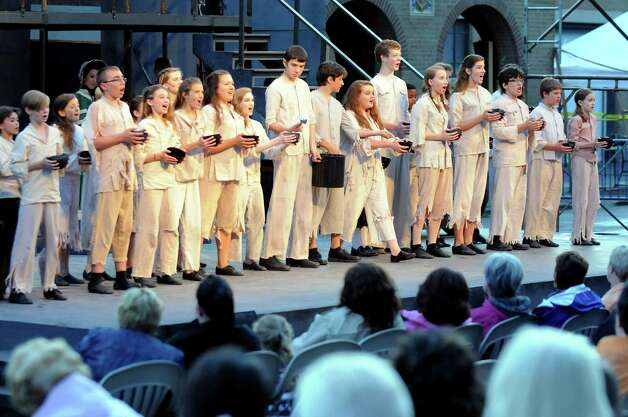 "The opening act of the Park Playhouse production of ""Oliver"" on Thursday, Aug. 7, 2014, at Washington Park in Albany, N.Y. (Cindy Schultz / Times Union) Photo: Cindy Schultz / 00028077A"