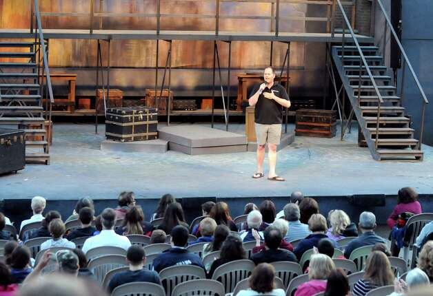 "Owen Smith, producing artistic director of Park Playhouse, welcomes patrons at the start of ""Oliver"" on Thursday, Aug. 7, 2014, at Washington Park in Albany, N.Y. (Cindy Schultz / Times Union) Photo: Cindy Schultz / 00028077A"