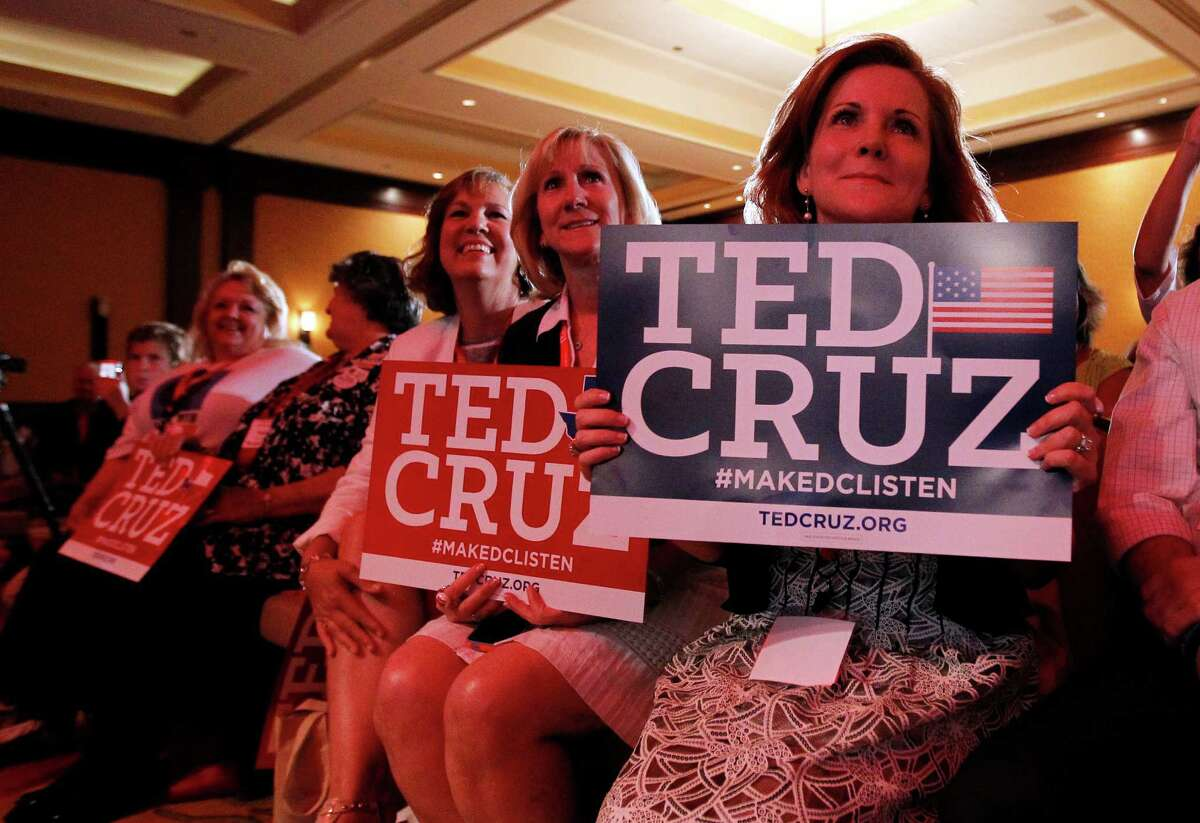 """Kay Hymel, from right, Kathy Szeszycki, both of New Orleans and Elle McKnight, third from right, of Pensacola, Fla., hold Ted Cruz signs as they listen to the senator deliver a speech to 2014 Red State Gathering attendees, Friday, Aug. 8, 2014, in Fort Worth, Texas. Possible presidential candidate Cruz predicts Republicans will retake the Senate this year and that """"2016 will be even better."""" (AP Photo/Tony Gutierrez)"""