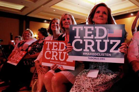 "Kay Hymel, from right, Kathy Szeszycki, both of New Orleans and Elle McKnight, third from right, of Pensacola, Fla., hold Ted Cruz signs as they listen to the senator deliver a speech to 2014 Red State Gathering attendees, Friday, Aug. 8, 2014, in Fort Worth, Texas. Possible presidential candidate Cruz predicts Republicans will retake the Senate this year and that ""2016 will be even better."" (AP Photo/Tony Gutierrez)"
