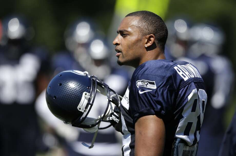 Wide receiver Doug Baldwin stands on the sidelines at Seahawks training camp. Photo: Elaine Thompson, Associated Press