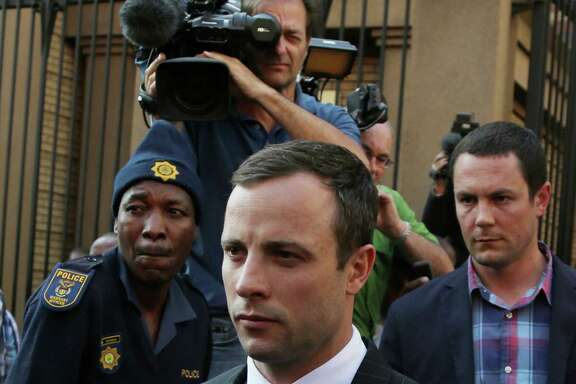 Oscar Pistorius leaves the high court in Pretoria, South Africa, Friday, Aug. 8, 2014. The judge in the murder trial of Oscar Pistorius says she will give a verdict on Sept. 11. (AP Photo/Themba Hadebe)