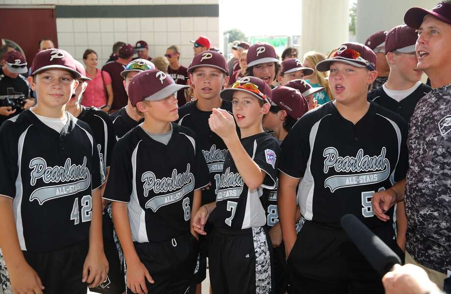 8/8/14: Presley Smith,(LF) and teammates look around in wonder as the press surrounds the little league Pearland baseball team at the Pearland Little League send off fundraise party at the RIG in Pearland, TX. (Photo by Thomas B. Shea for the Houston Chronicle).