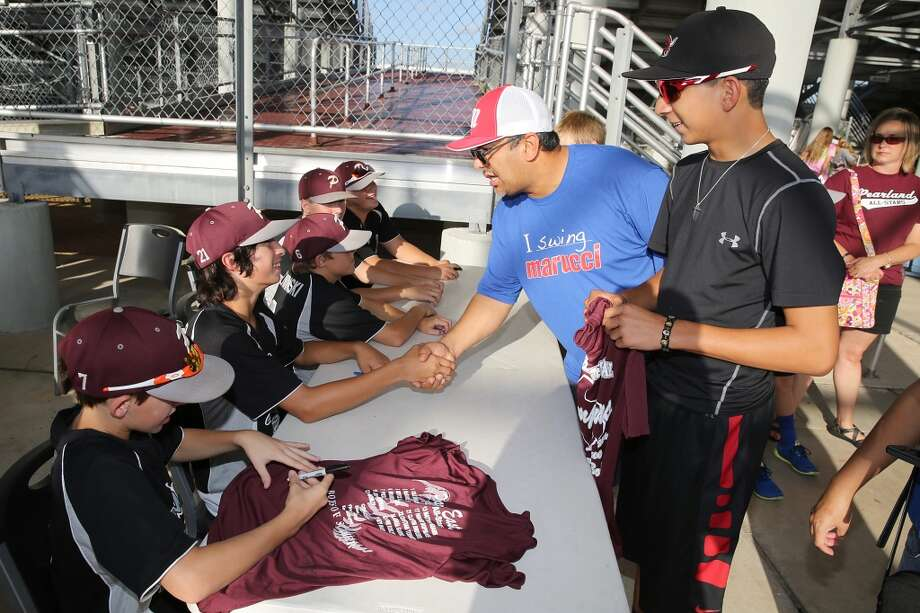 8/8/14: Carlos Calvillo. age 14 waits to have his t-shirt signed by the Pearland little leaguers at the Pearland Little League send off fundraise party at the RIG in Pearland, TX. (Photo by Thomas B. Shea for the Houston Chronicle).