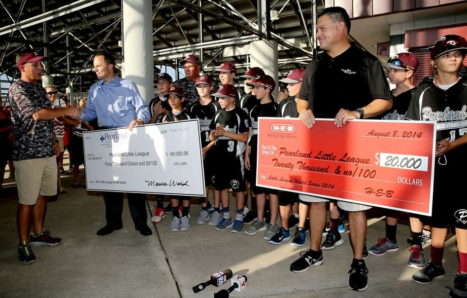 8/8/14: Pearland head coach Don Smith, thanks the Pearland Medical Center and Pearland HEB for a generous donation at the Pearland Little League send off fundraise party at the RIG in Pearland, TX. (Photo by Thomas B. Shea for the Houston Chronicle).
