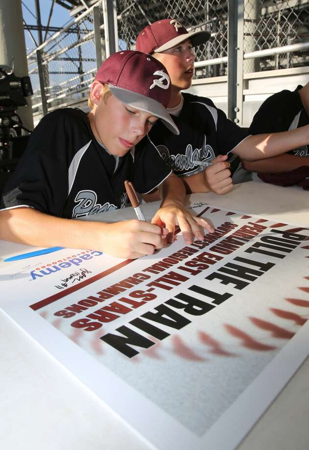 8/8/14: Brandon Sliwinski #6 and Jonathan Newman #11 sign autographs at the Pearland Little League send off fundraise party at the RIG in Pearland, TX. (Photo by Thomas B. Shea for the Houston Chronicle).