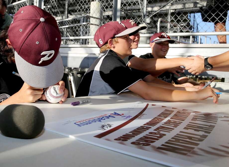 8/8/14: From left to right, Clayton Broeder, #21, Brandon Sliwinski #6, Jonathan Newman and  #11, Trey Maeker, #53sign autographs and shake handset the Pearland Little League send off fundraise party at the RIG in Pearland, TX. (Photo by Thomas B. Shea for the Houston Chronicle).