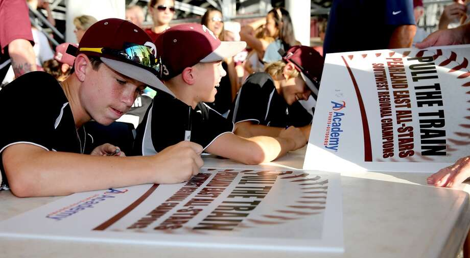 8/8/14: From left to right, Cole Smajstrla #1 and Bryce Laird #3 sign autographs at the Pearland Little League send off fundraise party at the RIG in Pearland, TX. (Photo by Thomas B. Shea for the Houston Chronicle).