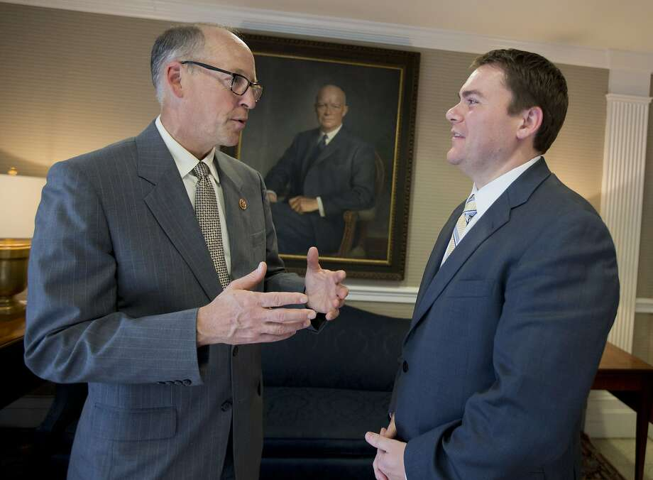 Rep. Greg Walden (left) of Oregon, chairman of the National Republican Congressional Committee, visits with House candidate Carl DeMaio of San Diego. Photo: Manuel Balce Ceneta, Associated Press