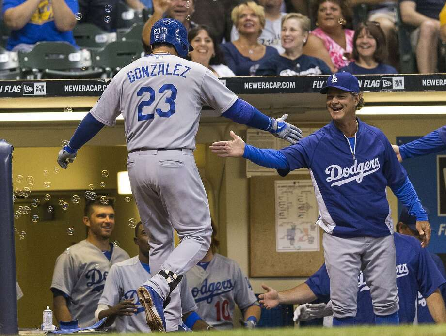 Adrian Gonzalez is greeted by manager Don Mattingly and a bunch of bubbles after a homer. Photo: Tom Lynn, Getty Images