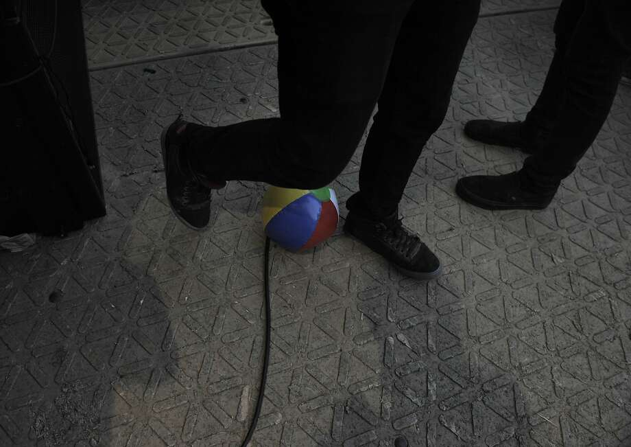 A photographer steps over a beach ball thrown from the crowd during the performance of Disclosure on the Lands End stage at Outside Lands Music Festival in Golden Gate Park on August 08, 2014 in San Francisco, CA. Photo: Craig Hudson, The Chronicle