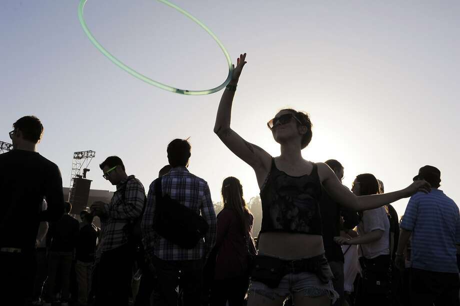 Hannah Gregory practices moves with a hoola hoop on the Polo Field at the Outside Lands Music Festival in Golden Gate Park on August 08, 2014 in San Francisco, CA. Photo: Craig Hudson, The Chronicle