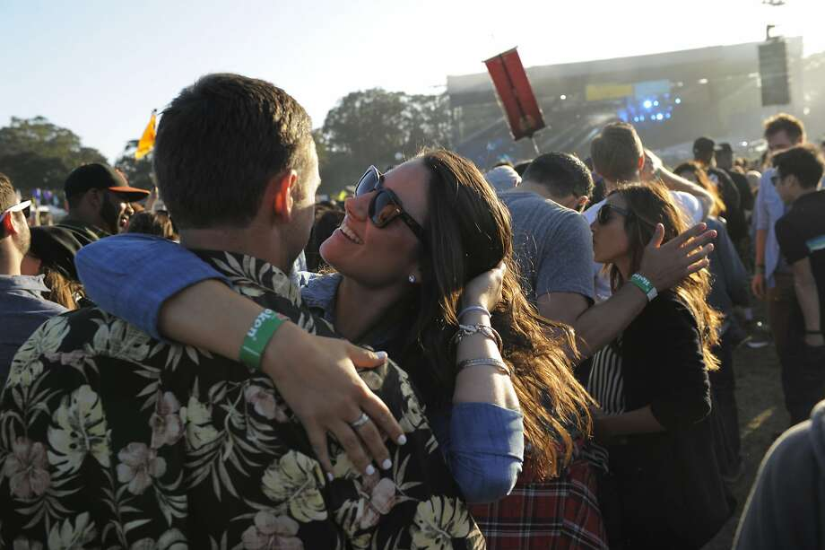 Tessa Davis embraces Max Angell at the Outside Lands Music Festival in Golden Gate Park on August 08, 2014 in San Francisco, CA. Photo: Craig Hudson, The Chronicle