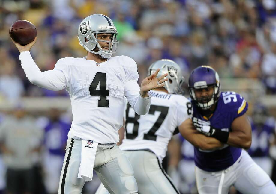 Derek Carr completed 10 of 16 passes for 74 yards in his NFL debut for Oakland. Photo: Hannah Foslien, Getty Images