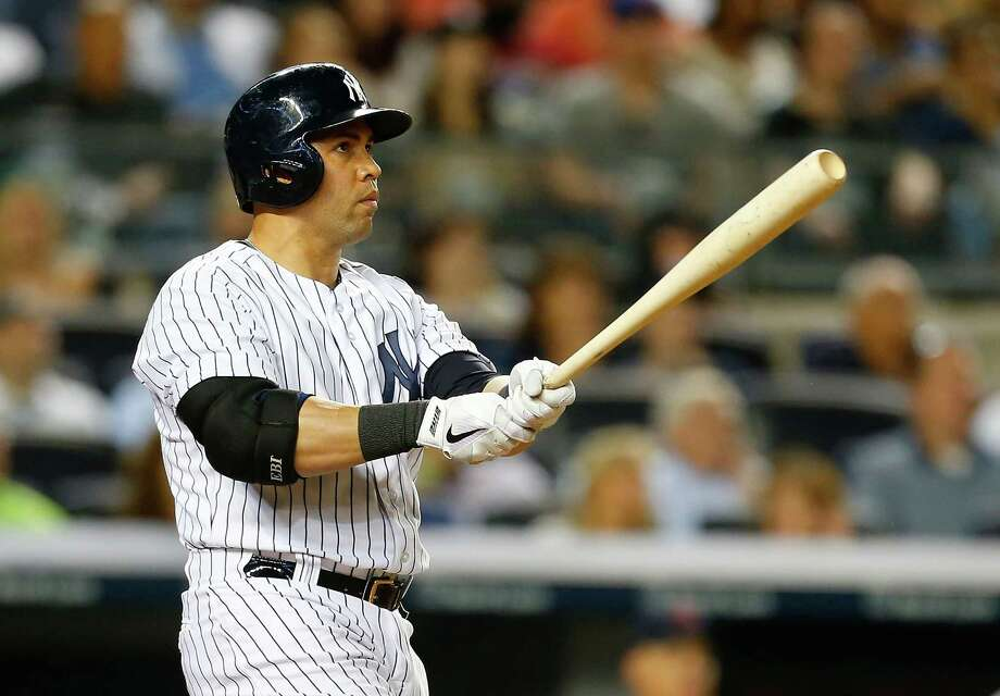 NEW YORK, NY - AUGUST 08:  Carlos Beltran #36 of the New York Yankees hits a grandslam in the sixth inning against the Cleveland Indians at Yankee Stadium on August 8, 2014 in the Bronx borough of New York City.  (Photo by Mike Stobe/Getty Images) ORG XMIT: 477587641 Photo: Mike Stobe / 2014 Getty Images