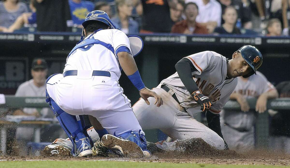 The Royals' Salvador Perez tags Joaquin Arias in the third for Nori Aoki's second outfield assist in the inning.
