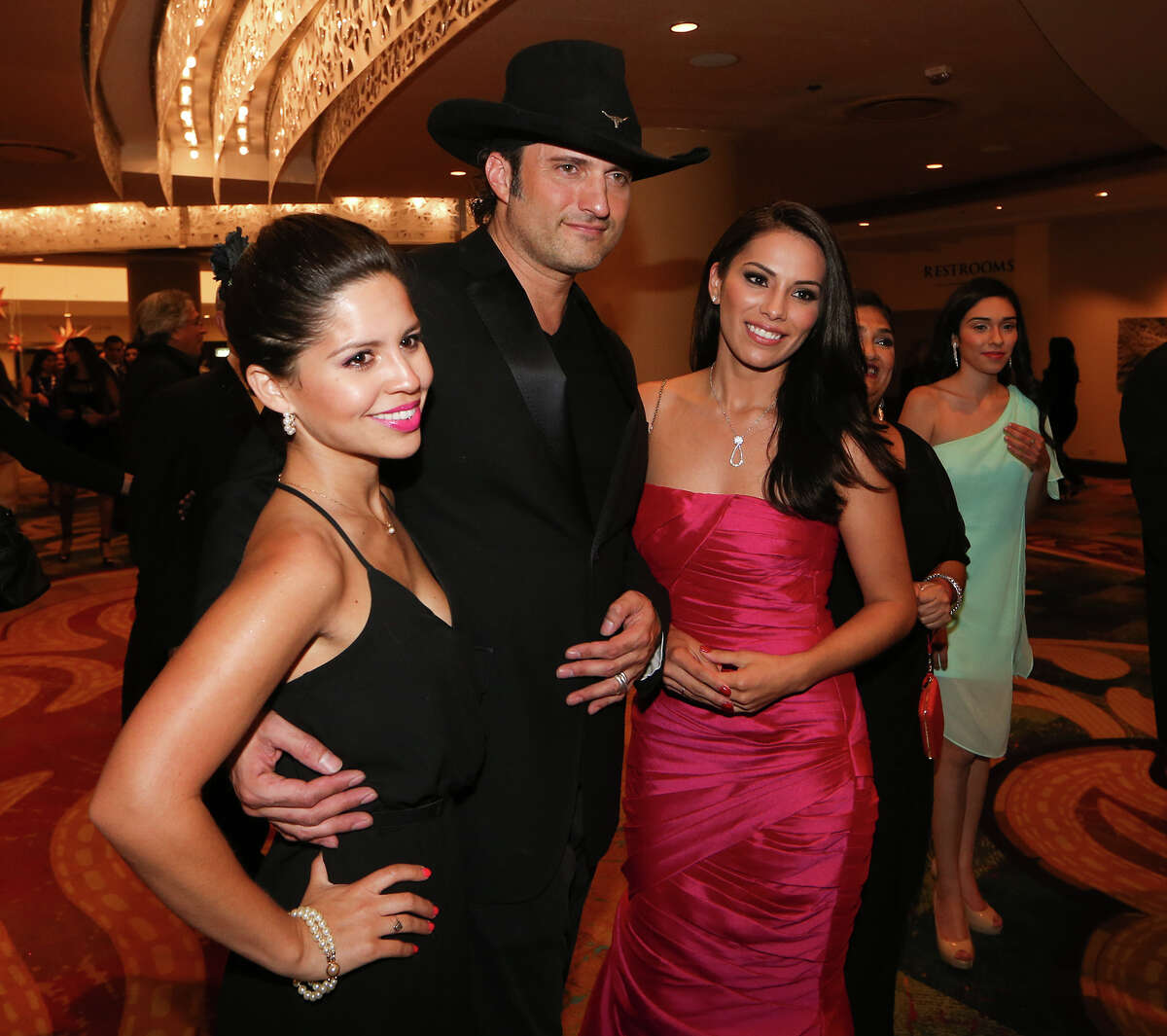 Filmmaker Robert Rodriguez (center) poses for a photo with Ana Cristina of La Prensa (left) and Mimi Gomez of KSAT during the reception for the San Antonio Association of Hispanic Journalists annual awards gala at the Marriott Rivercenter on Friday, August 8, 2014. MARVIN PFEIFFER/ mpfeiffer@express-news.net