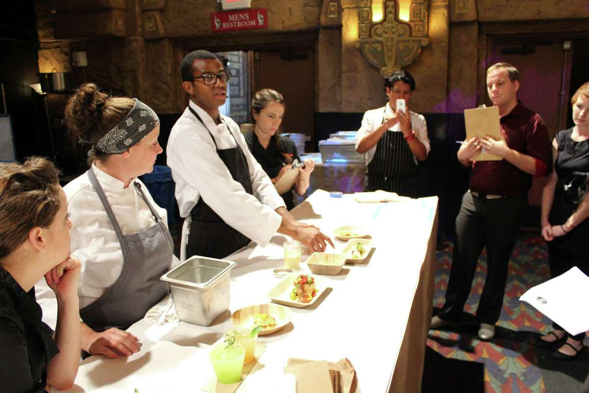 Before guests arrived, Chef Kwame Onwuachi presented a lineup of his menu to the Dinner Lab team. (Jennifer McInnis / San Antonio Express-News)