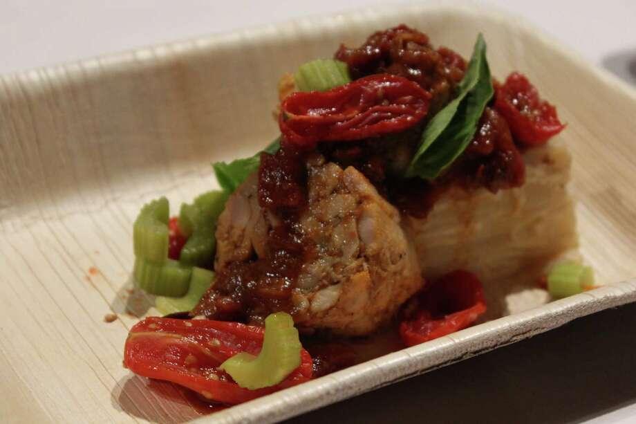 Chef Kwame Onwuachi's fourth course at Dinner Lab was braised chicken with smoked tomato ragu, braised celery, scalloped potatoes and garlic confit. (Jennifer McInnis / San Antonio Express-News) Photo: Jennifer McInnis