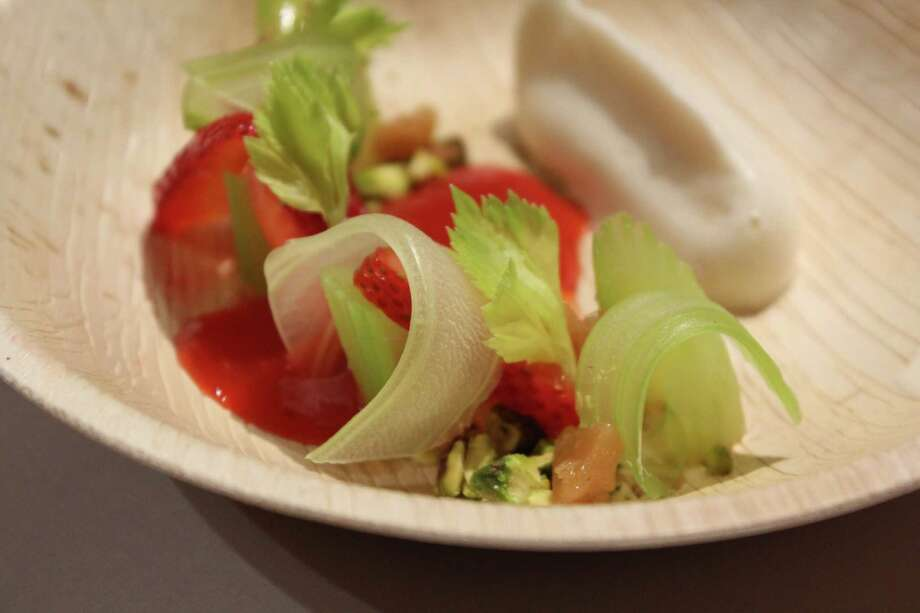 At the first Dinner Lab in San Antonio, Chef Kwame Onwuachi prepared a strawberry and celery salad as the first course, which featured pistachio brittle, strawberry pimenton vinaigrette, celery curls and whipped honey. (Jennifer McInnis / San Antonio Express-News) Photo: Jennifer McInnis