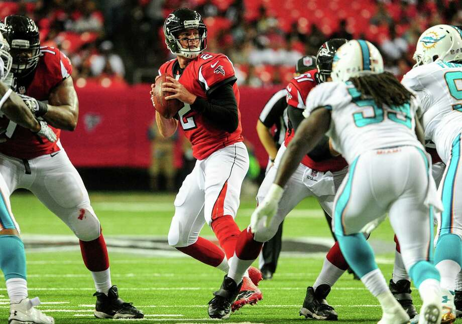 Atlanta's Matt Ryan surveys Miami's defense in the first quarter. He was 7 for 7 for 53 yards in a victory. Photo: Scott Cunningham / Getty Images / 2014 Getty Images