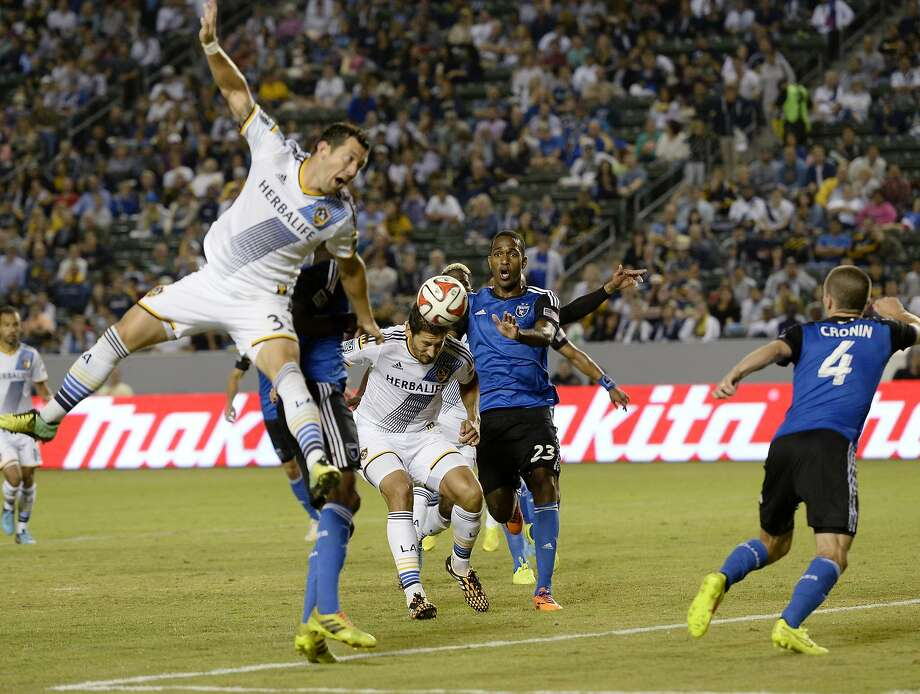 The Galaxy's Omar Gonzalez scores on a header despite the efforts of Quakes defender Atiba Harris. Photo: Kevork Djansezian, Getty Images