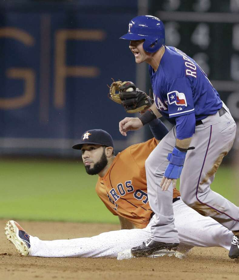 Texas' Daniel Robertson steals second in front of Houston shortstop Marwin Gonzalez in the seventh. Photo: Pat Sullivan / Associated Press / AP