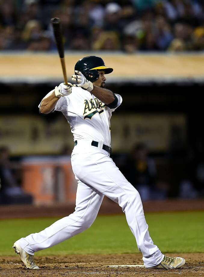 Coco Crisp smashes a triple in the fifth to give the A's a 3-0 lead. Photo: Thearon W. Henderson, Getty Images