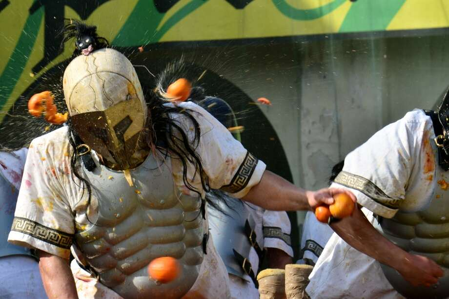 The massive fruit war has been enjoyed by more than 100,000 spectators. Awards are given by judges to the top-performing teams. Photo: GIUSEPPE CACACE, AFP/Getty Images