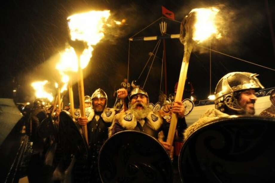 When night falls, participants take their giant torches and burn hand-built replicas of viking ships. Photo: AFP, AFP/Getty Images