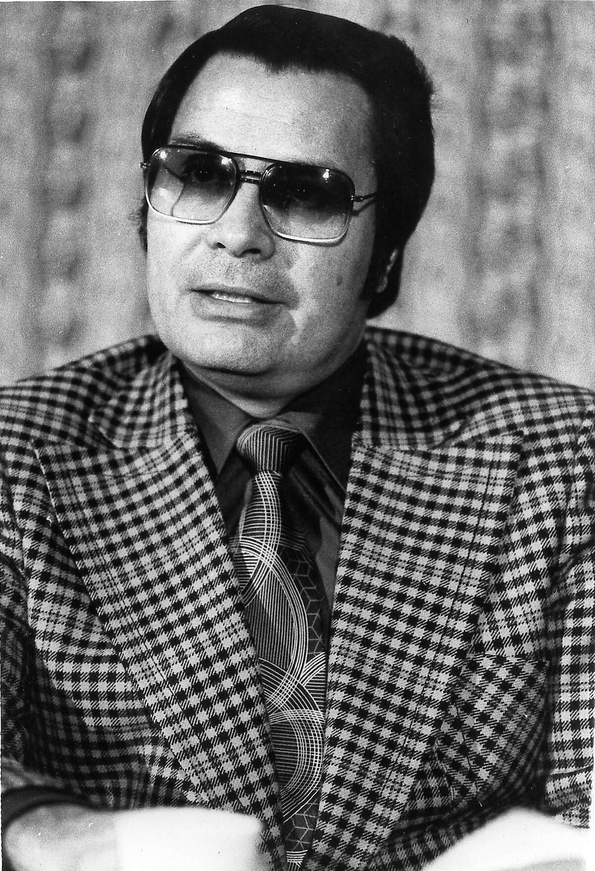 This J1976 photo shows the Rev. Jim Jones, pastor of peoples Temple in San Francisco. The cremated remains of nine victims of a 1978 mass cult suicide-murder in Jonestown, Guyana, have turned up in a former funeral home in Delaware, officials said Thursday, Aug. 7, 2014.