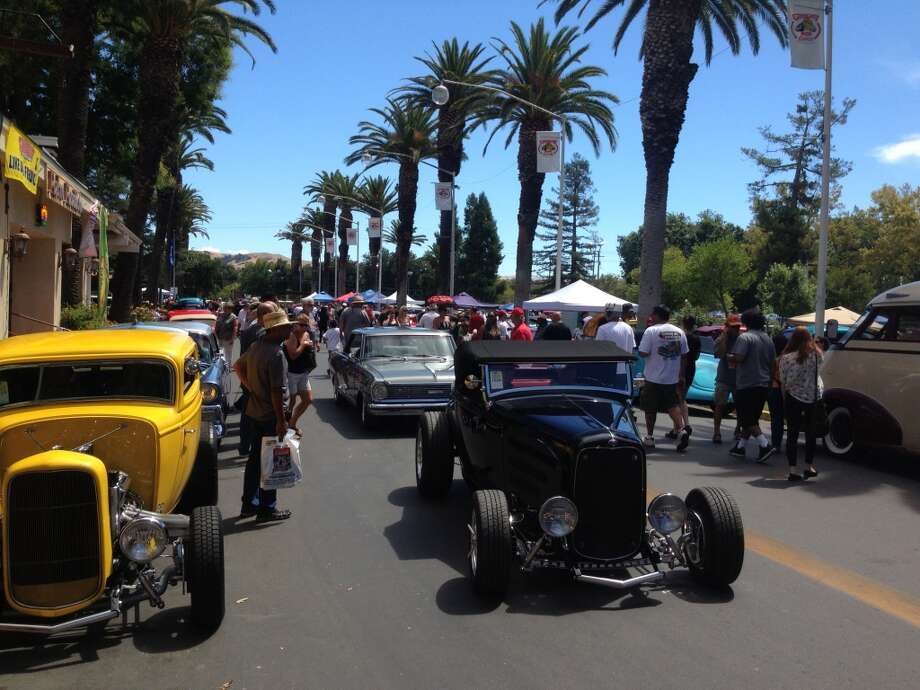 Show cars cruising Palm Avenue at the Alameda County Fairgrounds in Pleasanton, Calif., in August 2013. (Photo courtesy of the Goodguys Rod & Custom Association)