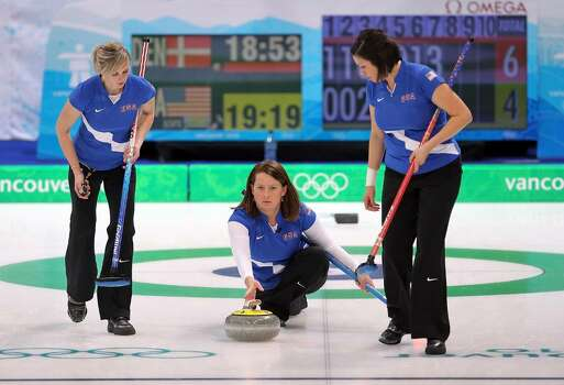 VANCOUVER, BC - FEBRUARY 18:  Skip Debbie McCormick of the USA delivers as Nicole Joraanstad and Natalie Nicholson sweep during the women's curling round robin game against Denmark on day 7 of the Vancouver 2010 Winter Olympics at Vancouver Olympic Centre on February 18, 2010 in Vancouver, Canada.  (Photo by Jamie Squire/Getty Images) *** Local Caption *** Debbie McCormick;Nicole Joraanstad;Natalie Nicholson Photo: Jamie Squire, Getty Images / 2010 Getty Images