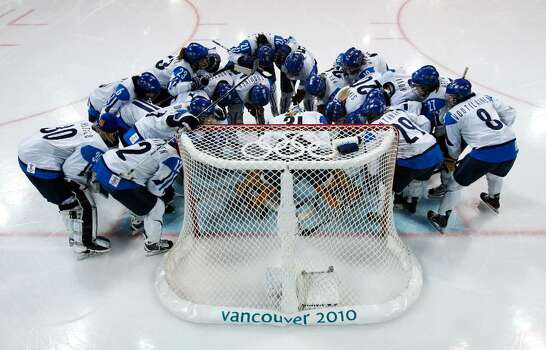 VANCOUVER, BC - FEBRUARY 18:  Finland players stand around the goal during the ice hockey women's preliminary game between USA and Finland on day 7 of the 2010 Vancouver Winter Olympics at UBC Thunderbird Arena on February 18, 2010 in Vancouver, Canada.  (Photo by Harry How/Getty Images) Photo: Harry How, Getty Images / 2010 Getty Images