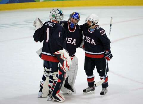 VANCOUVER, BC - FEBRUARY 18:  Goalkeeper Jessie Vetter of the United States celebrates with her team mates aduring ice hockey women's preliminary game between USA and Finland on day 7 of the 2010 Vancouver Winter Olympics at UBC Thunderbird Arena on February 18, 2010 in Vancouver, Canada.  (Photo by Harry How/Getty Images) *** Local Caption *** Jessie Vetter Photo: Harry How, Getty Images / 2010 Getty Images