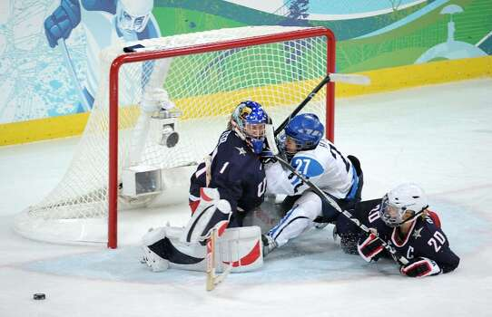 VANCOUVER, BC - FEBRUARY 18: Goalkeeper Molly Schaus of the United States collides with Anne Helin of Finland and team mate Natalie Darwitz during the ice hockey women's preliminary game between USA and Finland on day 7 of the 2010 Vancouver Winter Olympics at UBC Thunderbird Arena on February 18, 2010 in Vancouver, Canada.  (Photo by Harry How/Getty Images) *** Local Caption *** Molly Schaus;Anne Helin;Natalie Darwitz Photo: Harry How, Getty Images / 2010 Getty Images