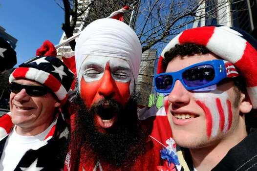 VANCOUVER, BC - FEBRUARY 18:  (L-R) Shane Moncrieff of Portland, Oregon, Amarjeet Jandhu of Surrey, Canada and Dylan Moncrieff (son of Shane) enjoy downtown Vancouver  on day seven of the Vancouver 2010 Winter Olympics on February 18, 2010 in Vancouver, Canada.  (Photo by Kevork Djansezian/Getty Images) *** Local Caption *** Shane Moncrieff;Amarjeet Jandhu;Dylan Moncrieff Photo: Kevork Djansezian, Getty Images / 2010 Getty Images