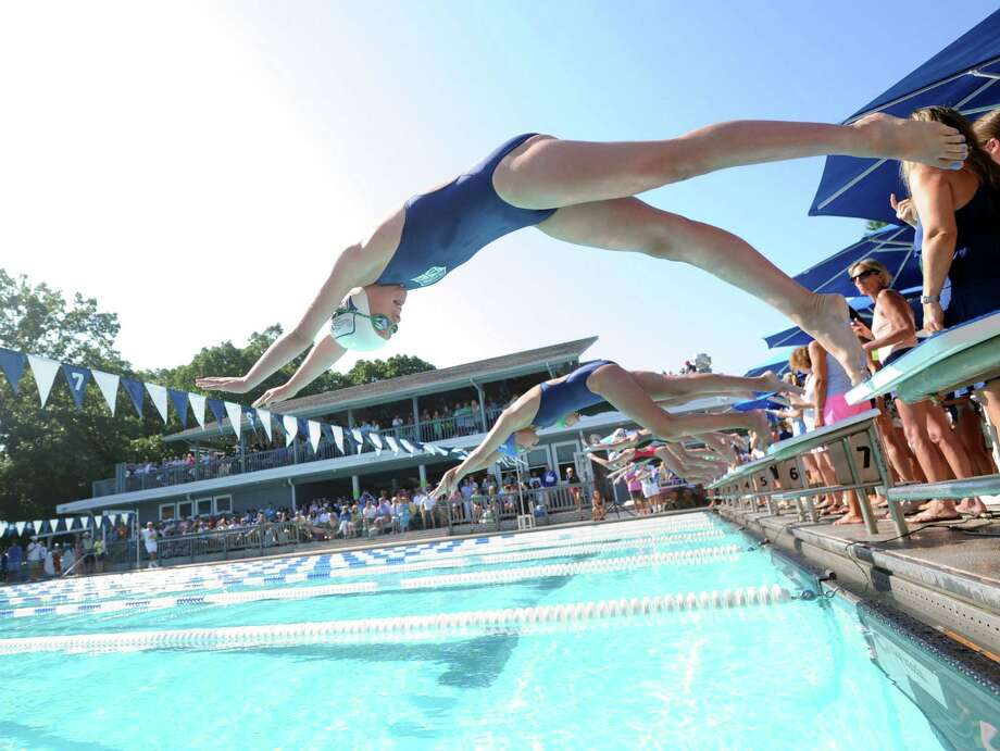 Caroline Crampton of the Shore & Country Club goes off the block during a race that was part of the Fairfield County Swimming League championship meet at the Roxbury Swim Club in Stamford, Conn., Saturday, Aug. 9, 2014. Photo: Bob Luckey / Greenwich Time